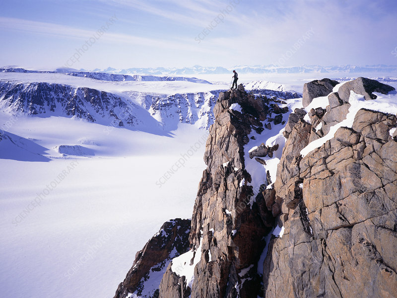Mountaineer on the summit of a Greenland peak