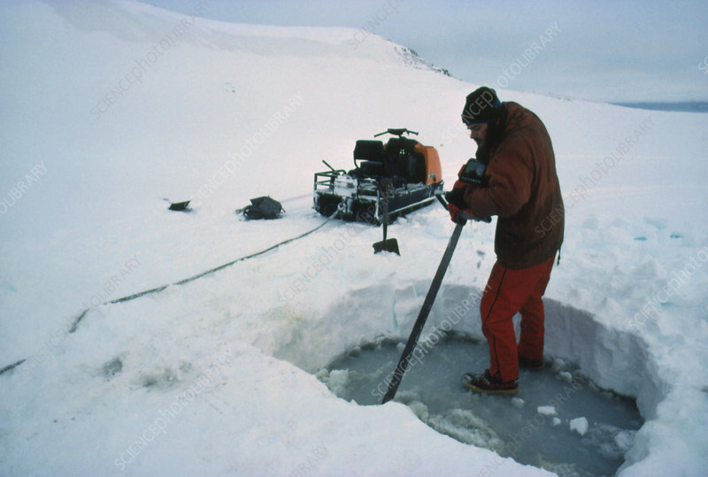 B.A.S/ scientist chainsawing hole in ice