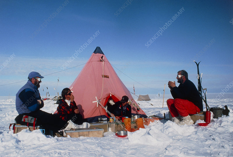 Antarctic research team relaxing outside tent