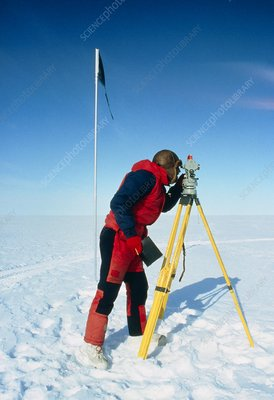 Glaciologist using theodolite on Ronne Ice Shelf