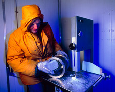 Scientist in a cold room with an ice core