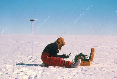 Researcher measures the flow rate of a glacier