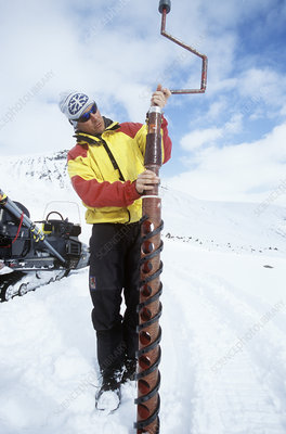 Glaciologist drilling an ice core, Sweden