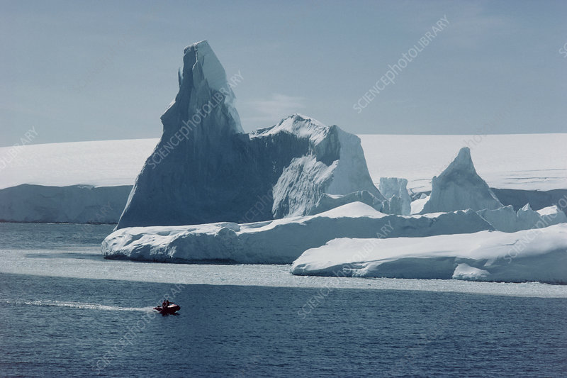 Iceberg in front of island icecap