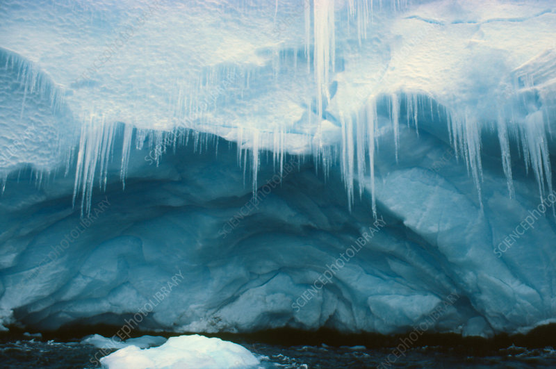 Icicles and cave on a coastal ice cliff, Antarctic