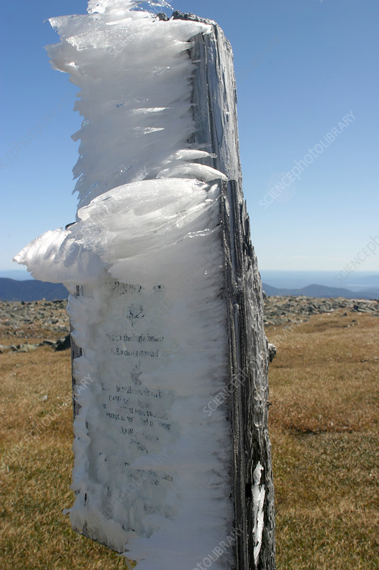 Ice on mountain signpost