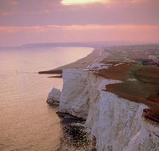Chalk cliffs and sandy beach.