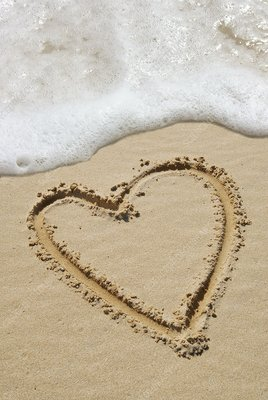 Heart-shape drawn in sand