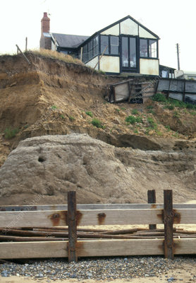 House located at the edge of a sea eroded cliff