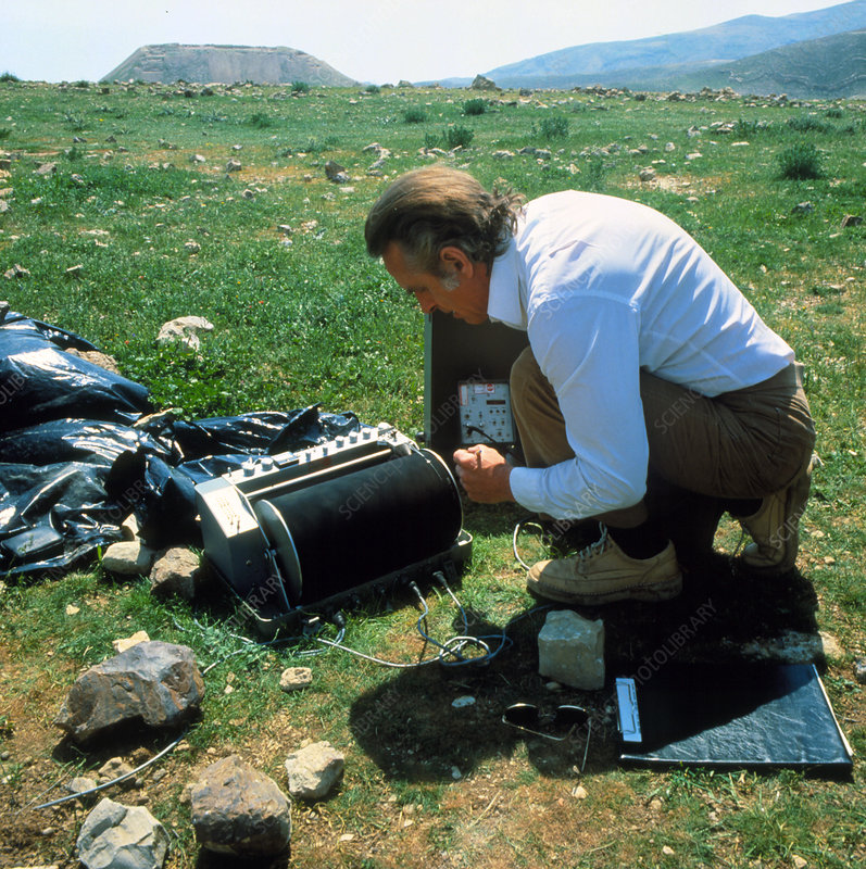 Geophysicist operating seismology equipment