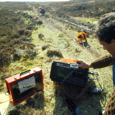 Geologists using portable seismology equipment