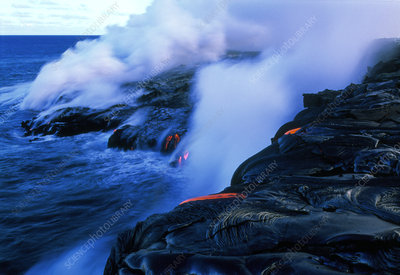 Molten lava flowing into the ocean