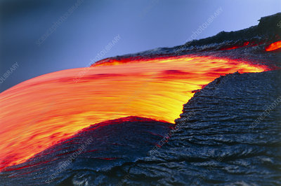Molten pahoehoe lava spilling from a lava tube