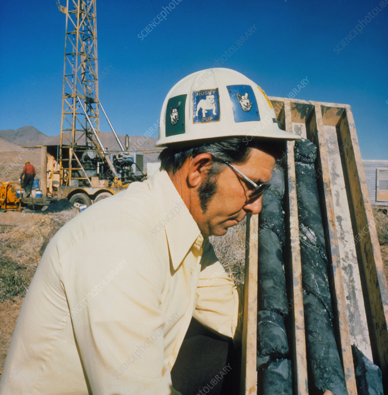 Geologist with core samples