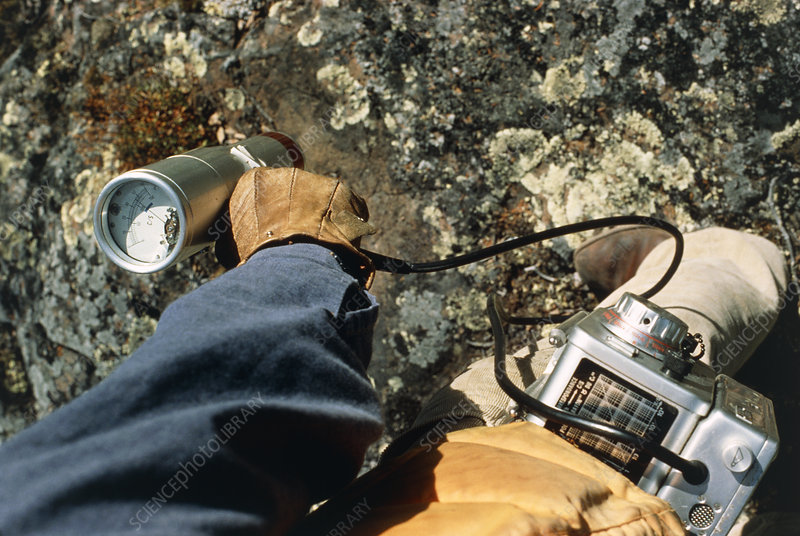 Geologist testing rocks with Geiger counter