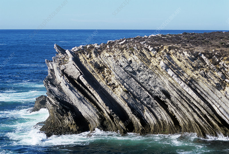 Inclined rock strata at the coast