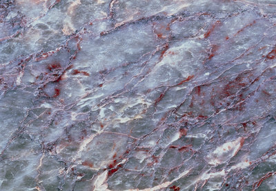 Cut surface of marble with impurities