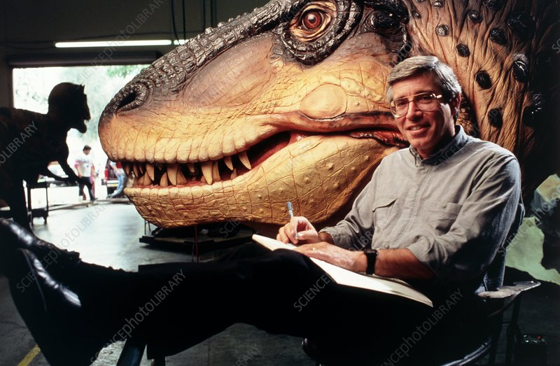 George Callison photographed with robotic dinosaur