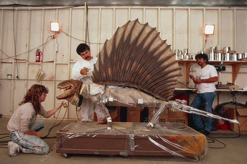 Technicians working on a robotic Dimetrodon
