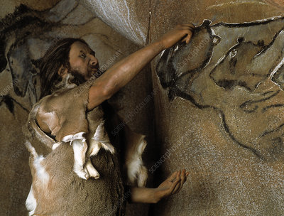 Model of a Cro-Magnon man doing a cave painting