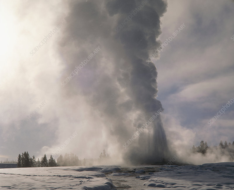 Old Faithful, view of geyser erupting in winter