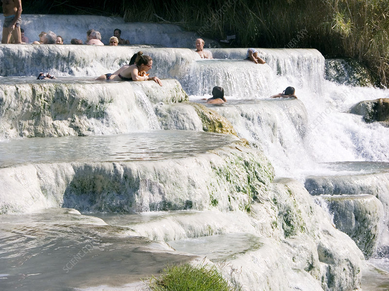 People bathing in mineral terraces