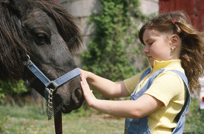 Child with pony