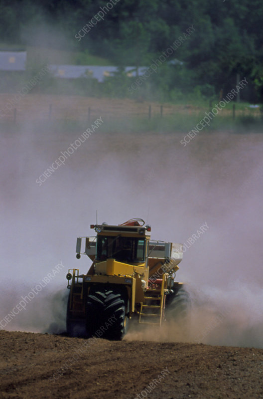 View of a tractor spreading lime