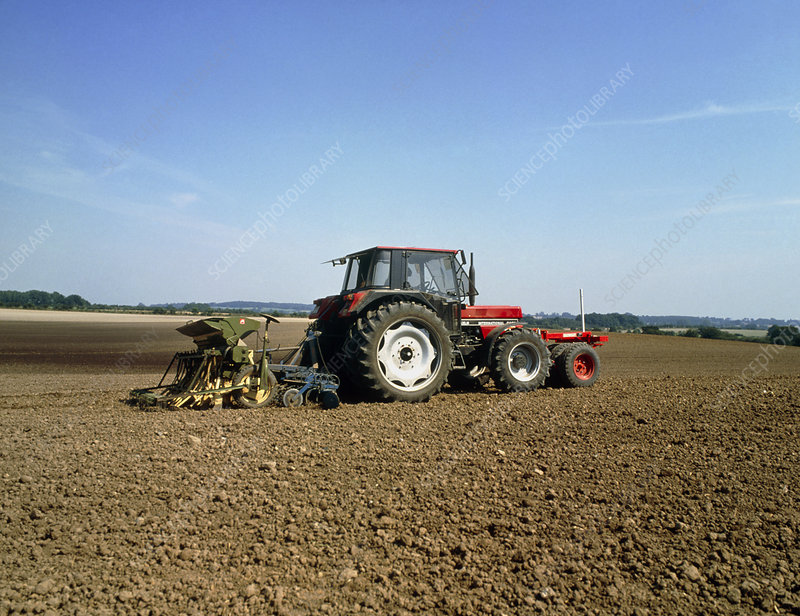 Tractor sowing seeds onto an agricultural field