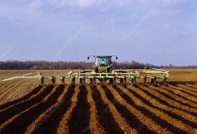Tractor creating furrows