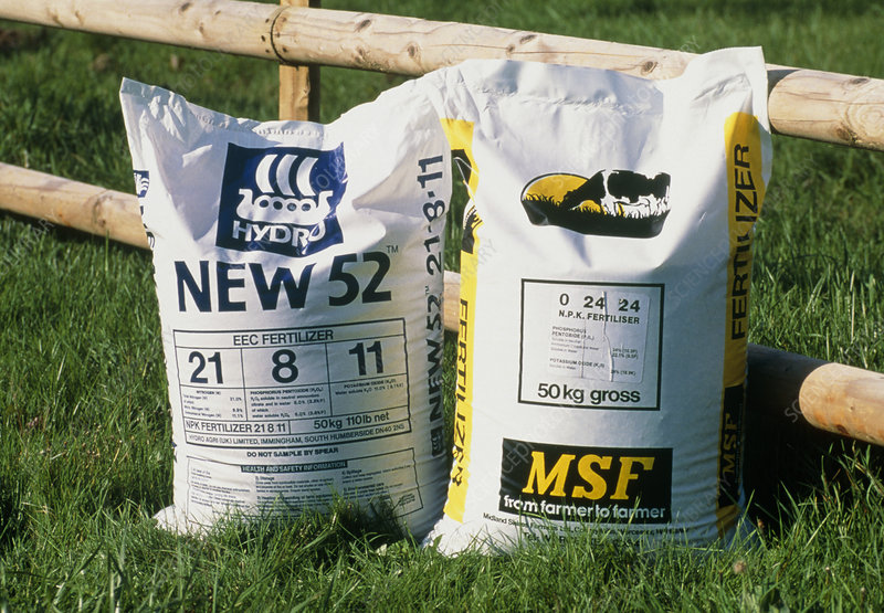 View of two bags of NPK fertiliser by a fence