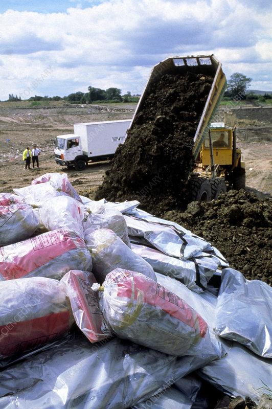 Sacks Of Asbestos Being Buried At Landfill Site Stock