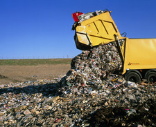 Landfill site with waste truck dumping refuse