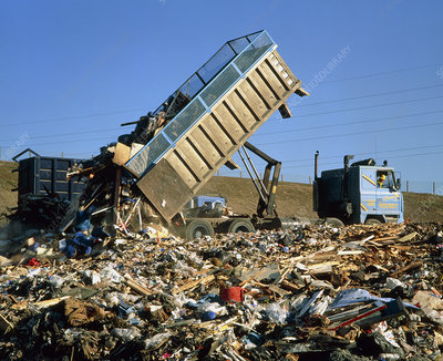 Landfill site with truck dumping refuse