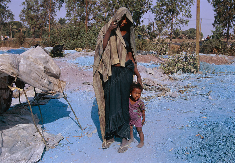Indian woman & child who live on a waste dump