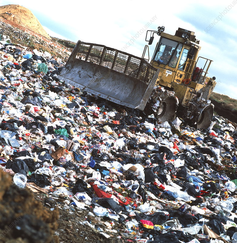 View of a bulldozer working a landfill refuse site