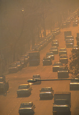 Smog over busy street in city of Buenos Aires