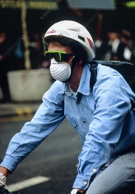 Cyclist wearing a fume mask.