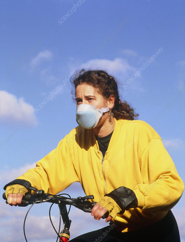 Cyclist wearing face mask to filter out fumes.