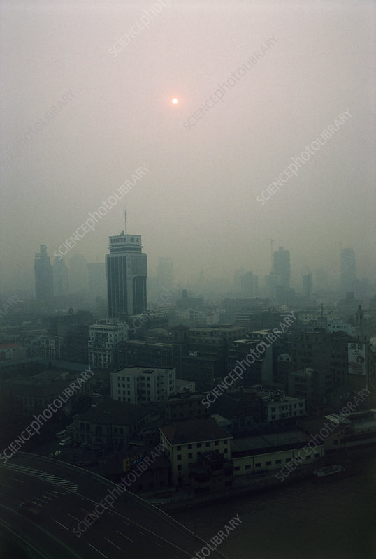 Air pollution over a city discolouring the Sun.