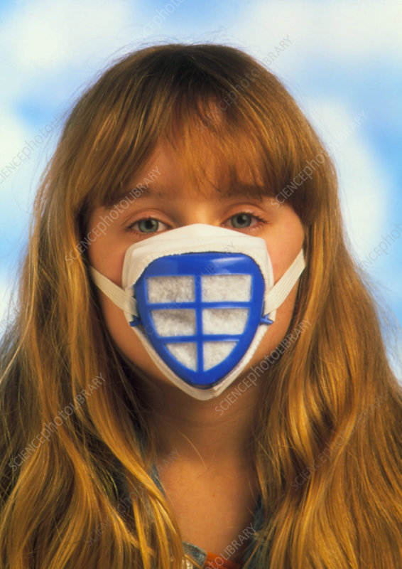 Child wears mask to protect against air pollution