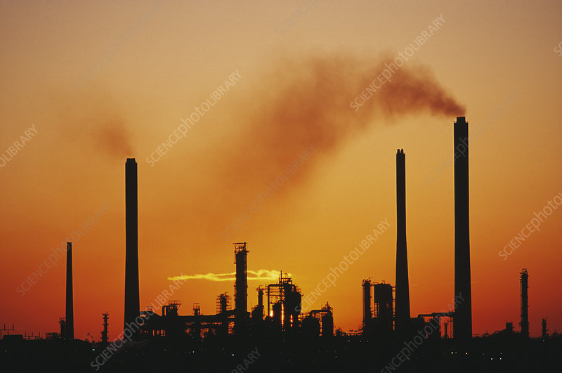 Industrial air pollution at sunset