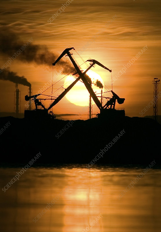 Industrial pollution at sunset