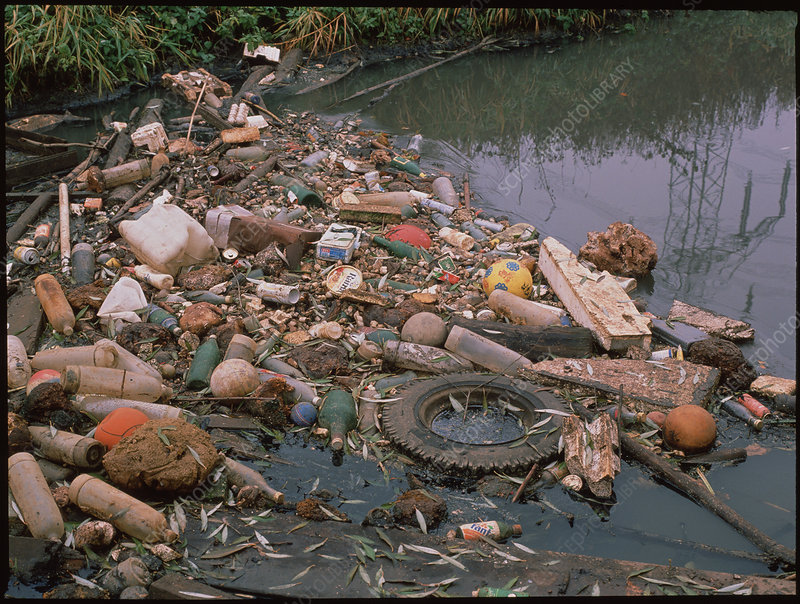 Rubbish filled river, Bitterfeld, Germany