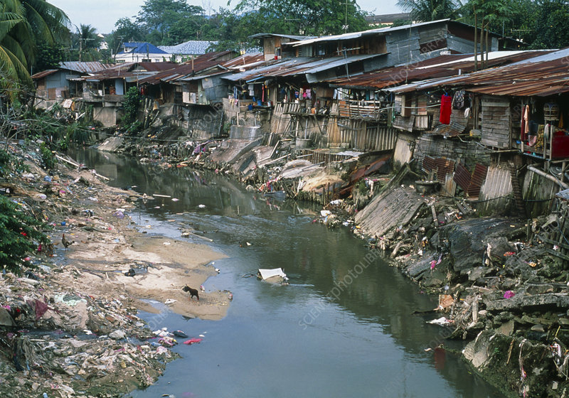 Polluted river running through a Malaysian slum