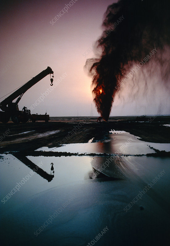 Gushing oil well and lake, Kuwait, July 1991