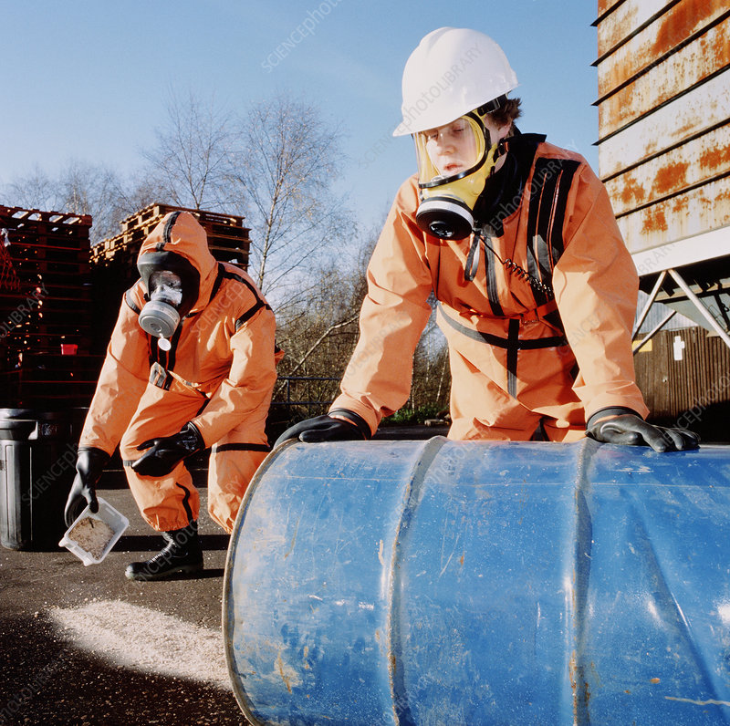 Workers cleaning up a chemical spill