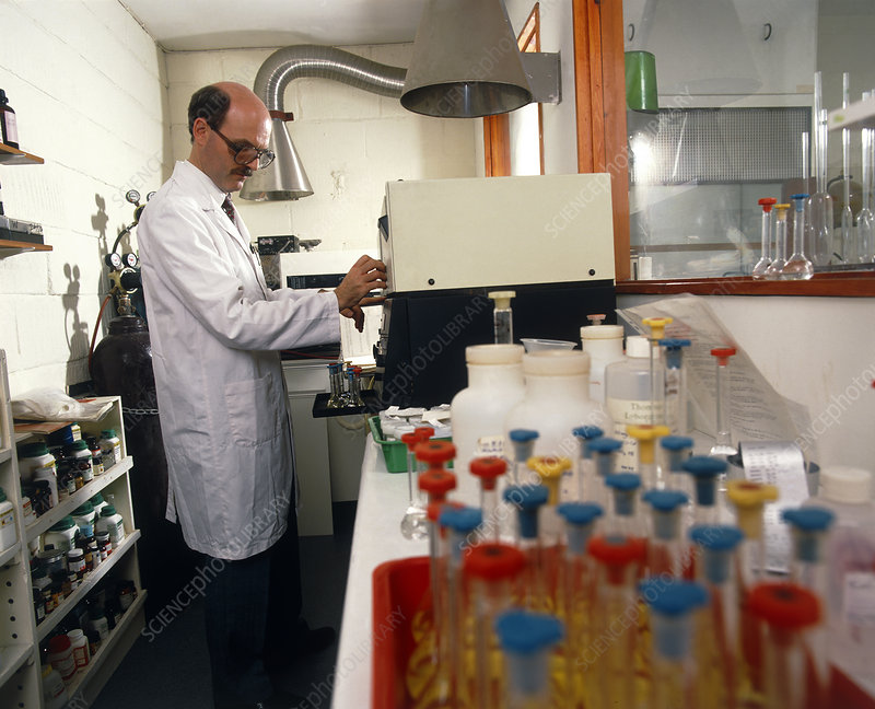 Scientist using a spectrometer