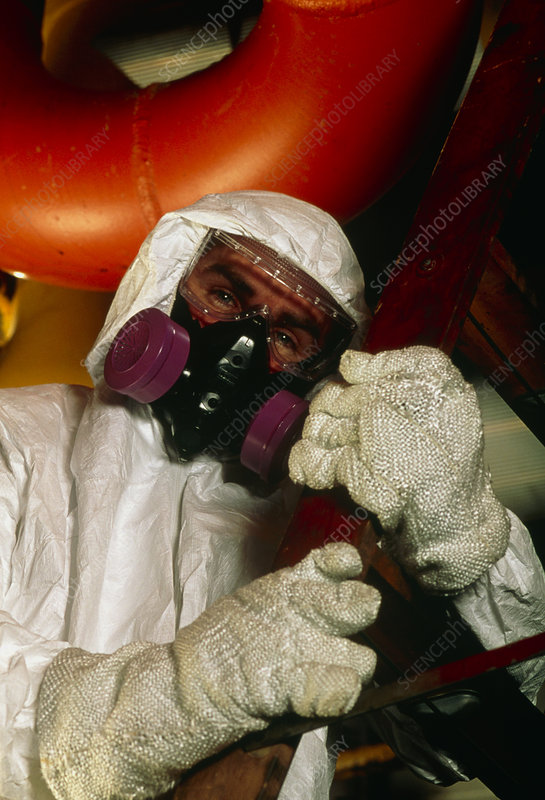 Technician wearing suit to protect from asbestos
