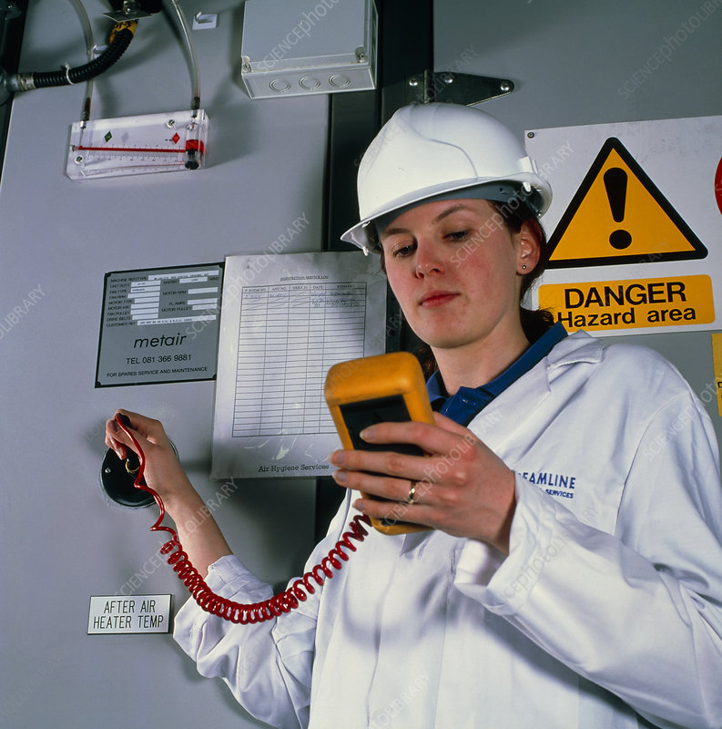 Technician monitoring pollutant levels in air